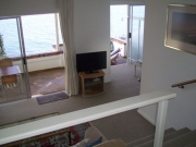 From dining room towards lounge, terrace and the sea