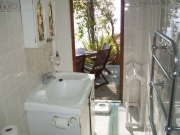 En suite to main bedroom is a  shower and toilet  opened to garden terrace