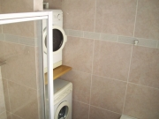 Washer and tumble drier tucked away in 2nd bathroom