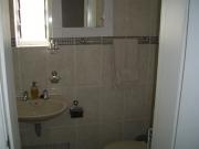 En suite toilet, shower and basin for main bedroom