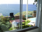 Main bedroom window opens onto terrace with super sea views