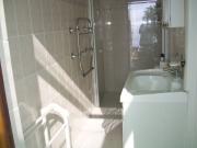 En suite shower, toilet and basin