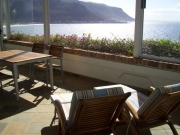 Views from the sunny terrace towards beach, Kalk Bay harbour and Muizenberg